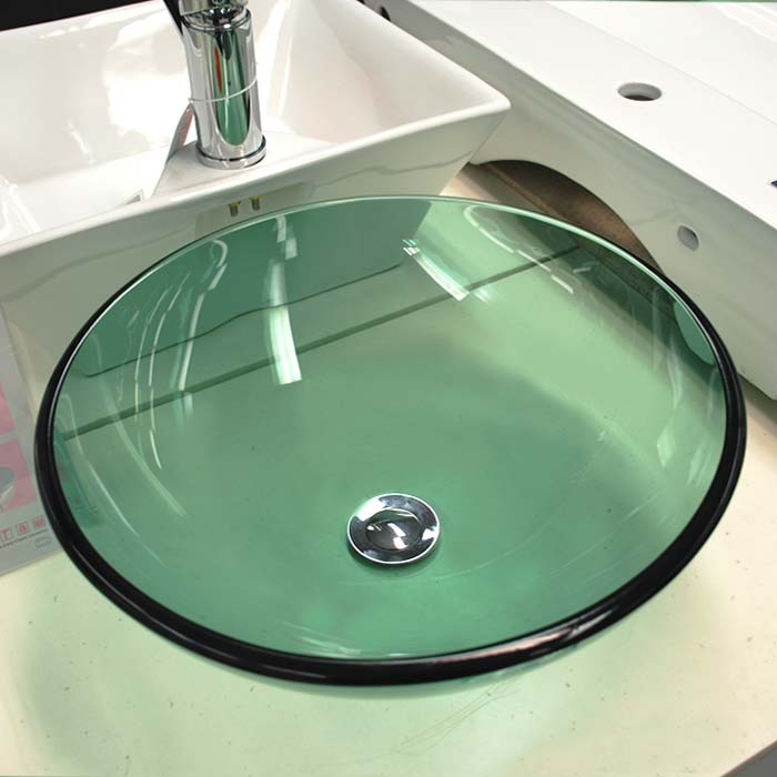 Round green glass above counter vessel basin