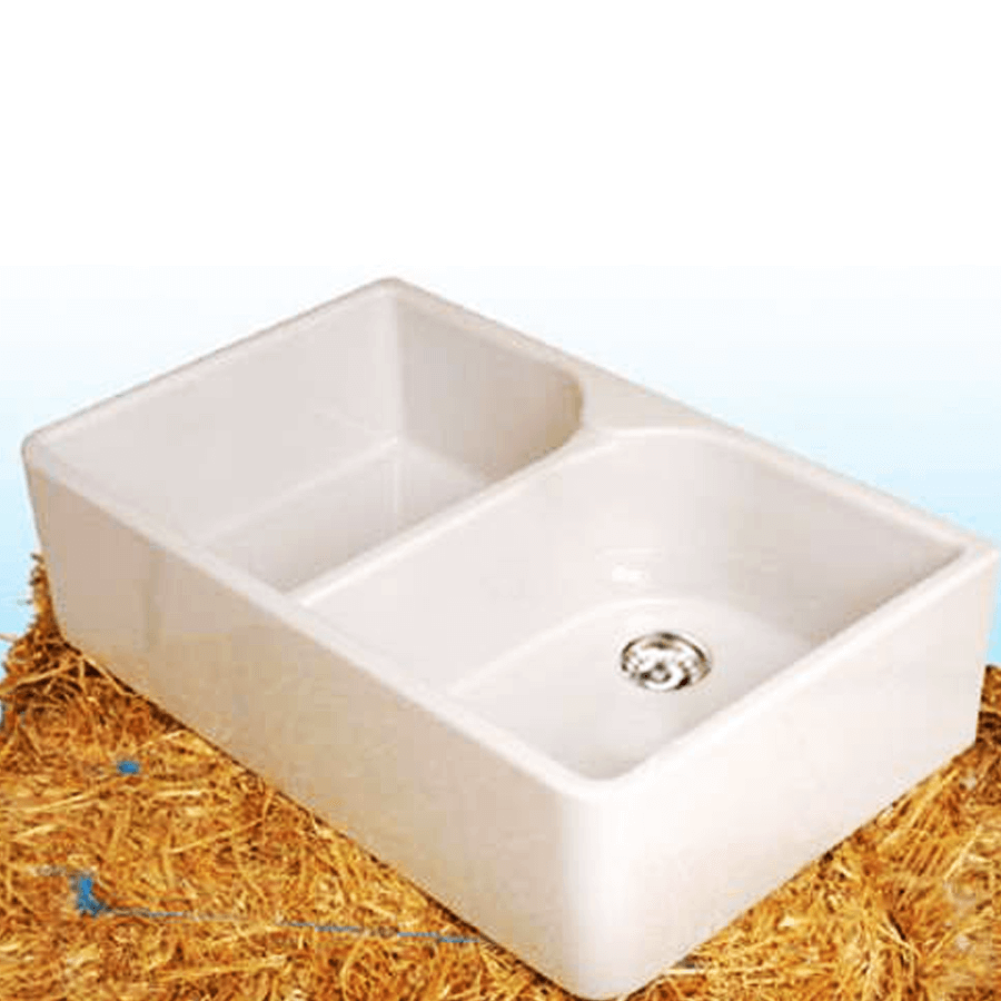 White ceramic double bowl sink with plugs